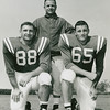 University at Buffalo football coach Dick Offenhamer with Bill Selent (#88) and Jack Hartman (#65) during the 1961 season.
