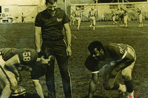 Chuck Donner (58) and Prentis Henley (70) with coach Bob Deming.