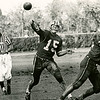University at Buffalo quarterback Kirk Barton (#15) lets fly with a 30 yard pass to John Faller (not in picture) as Zelmanski (#35) and Ellwell (#61) block during an October 3, 1970 game against UMass. Buffalo won the football game 16-13.