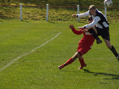 The Wishaw defender beats Steven Fitzpatrick to the ball