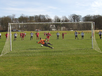 Penalty to Burgh. The Wishaw keeper saves John Sherry's penalty
