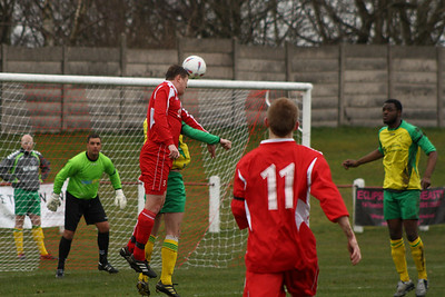 Chris Wozencroft gets his head to a corner