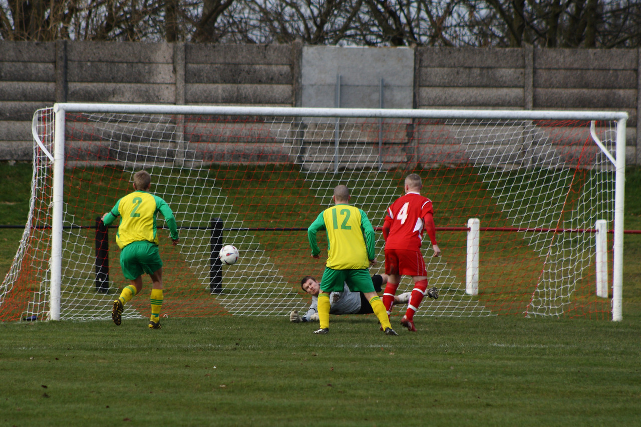 Fraser Wilson makes a good save from a free kick