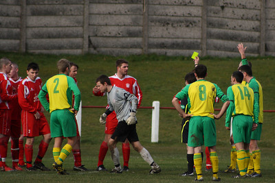 Fraser Wilson trots away after only getting a yellow card for making a foul outside his box
