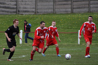 Colin Smith bringing the ball out of defence