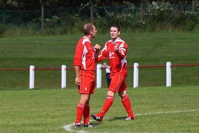Ian Ross calming Raymond Donaghy down