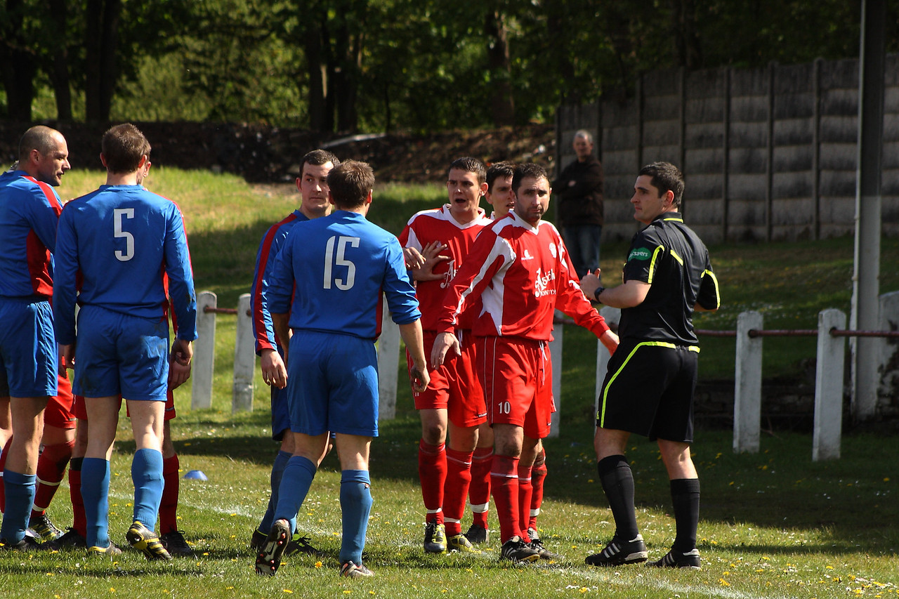 The referee dealing with Martin McIntyre after his lunge sees him get a red card