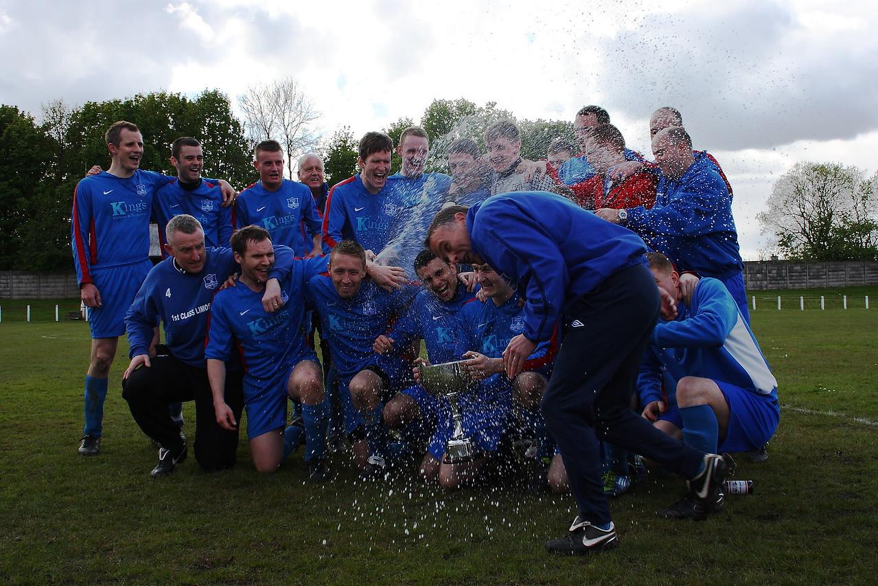 Carluke celebrate winning the league
