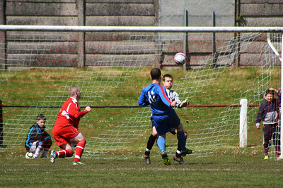 Fraser Wilson gets to the ball ahead of the Carluke forward