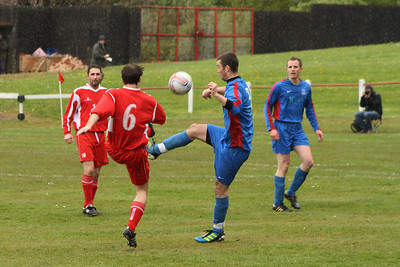 Chris Loughlin clearing the ball forward