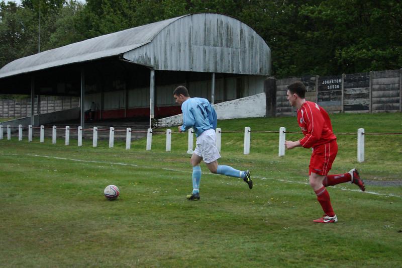 Grant Kelly brining the ball away