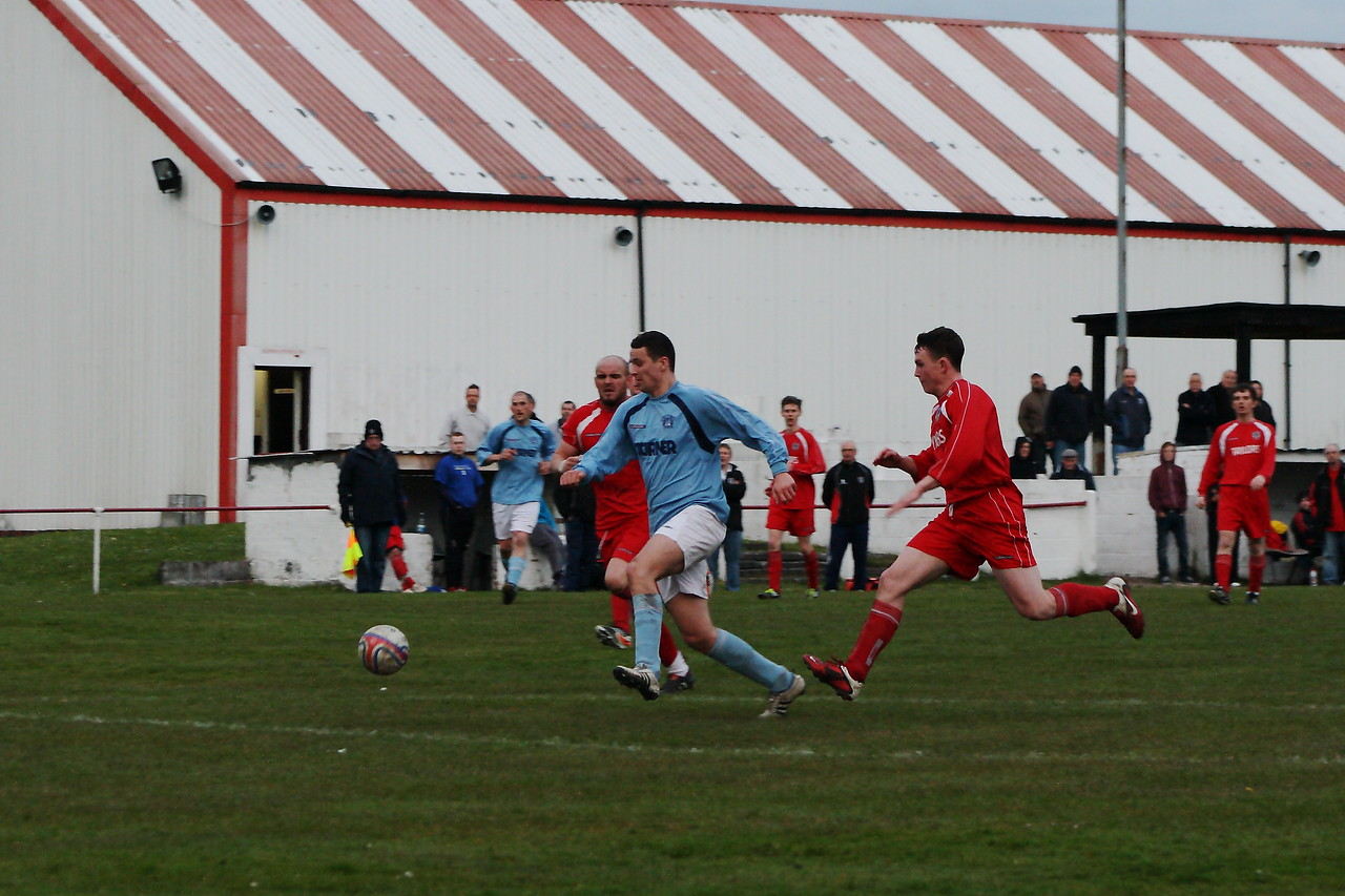 Joe McGinley attempting to round the keeper. He was brought down and was awarded a penalty