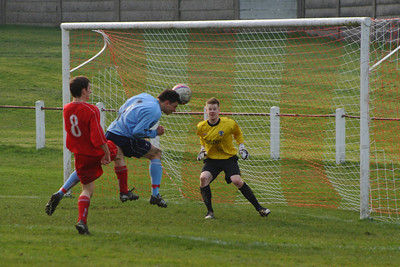 Martin McIntyre gets his head to a cross that smacked off the post