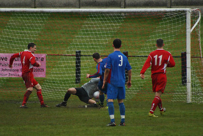 Fraser Wilson gets down to Block a shot at goal