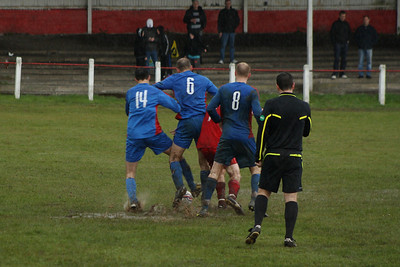 The moment the game was abandoned. Ball stuck in the water that was gathering and the ref decided to call a halt