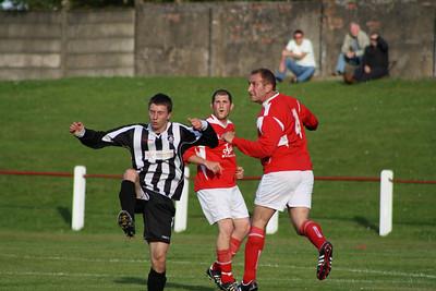 Raymond Donaghy heading the ball clear