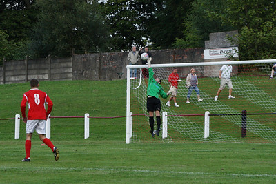 Port keeper Tucker can only parry Aiden Lennon's free kick...