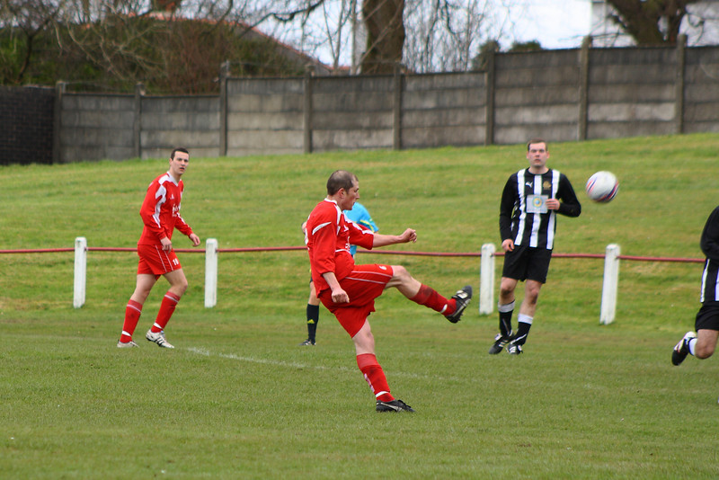 Ross Perrie launches his thunderbolt volley that nestled in the top corner for Burgh's equaliser