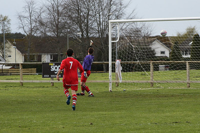 Whithills replacement keeper can do nothing with this shot which makes it 3-0 to St Ninians