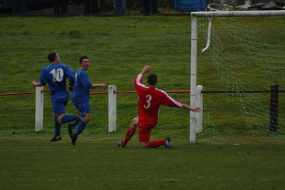 Johns Paul McKeown gets the block on a goalbound shot to keep the score 1-0