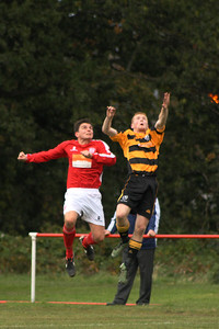 Martin McIntyre challenging for the ball