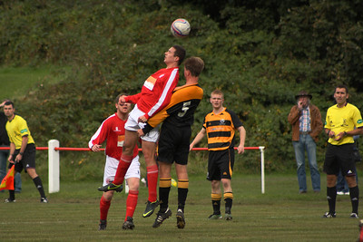 Joe McGinley gets his head to the ball