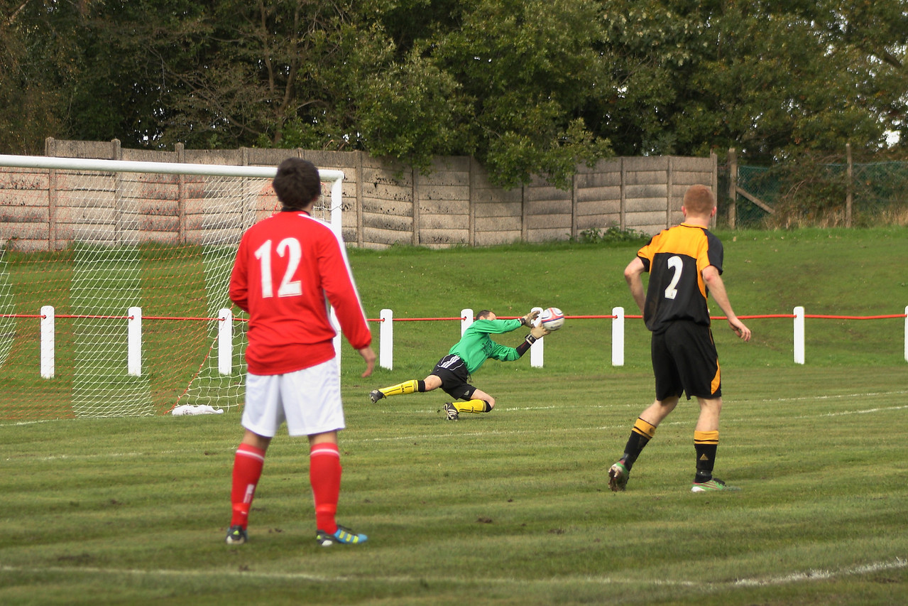 Largs keeper Connick clutches at a Colin Smith shot