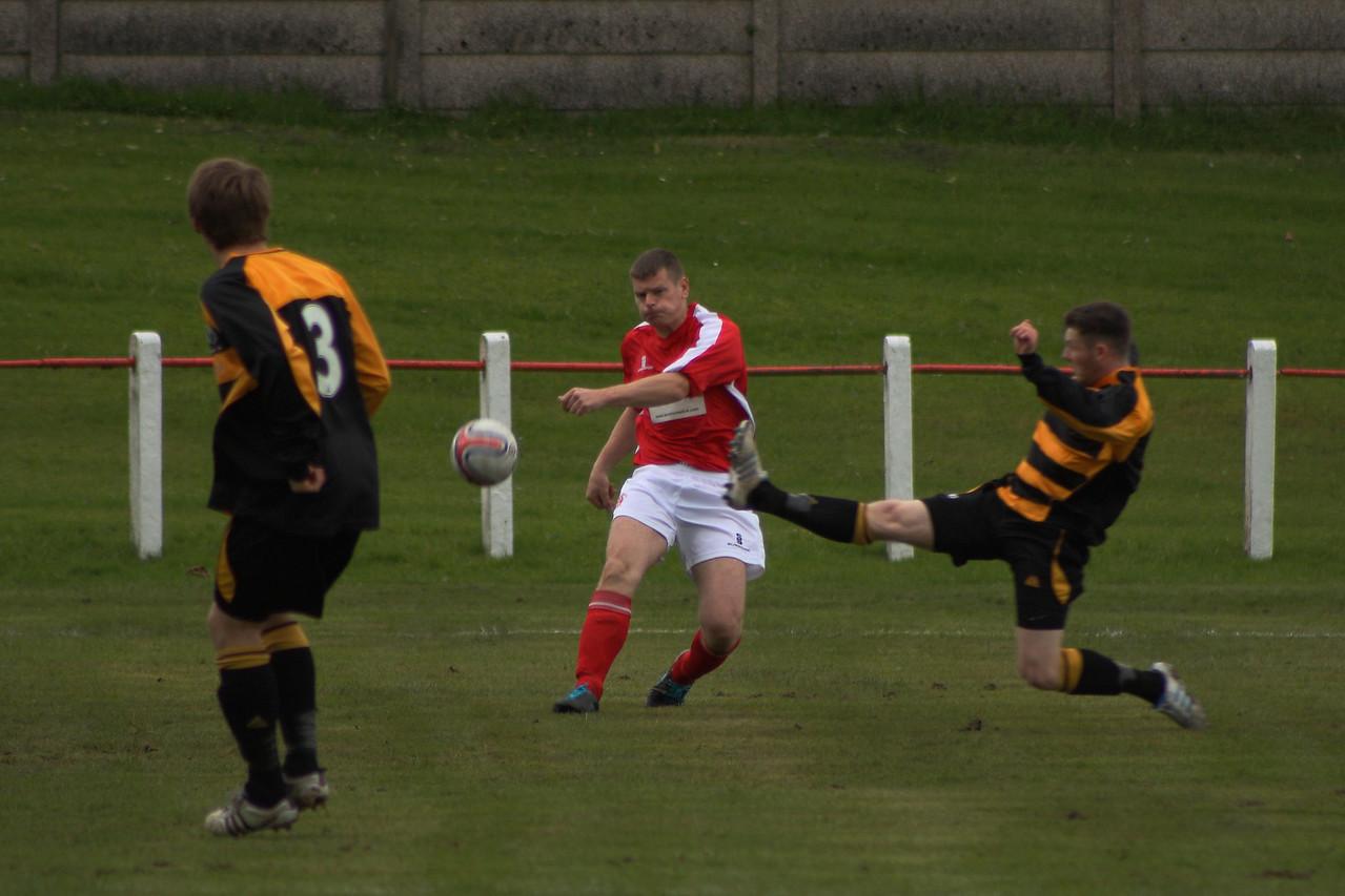 Derek Carson firing the ball forward