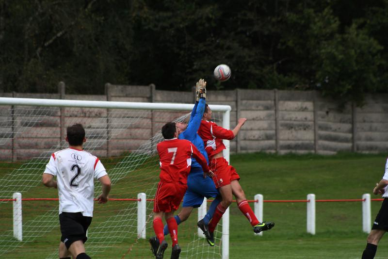 Joe McGinlay challenging the Rossvale goalkeeper