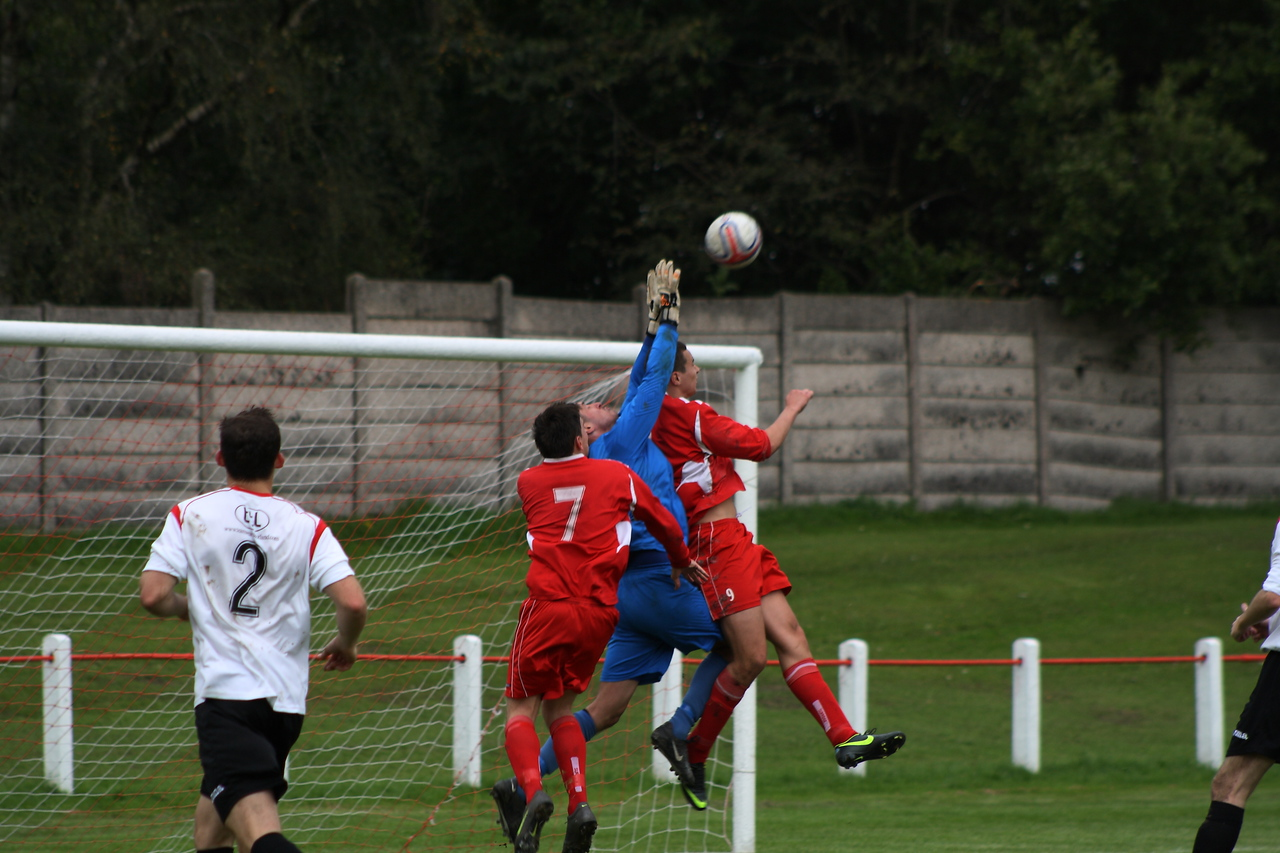 Joe McGinlay challenging the Rossvale goalkeeper