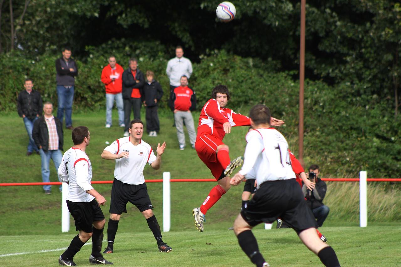 Steven Fitzpatrick firing a header across the box