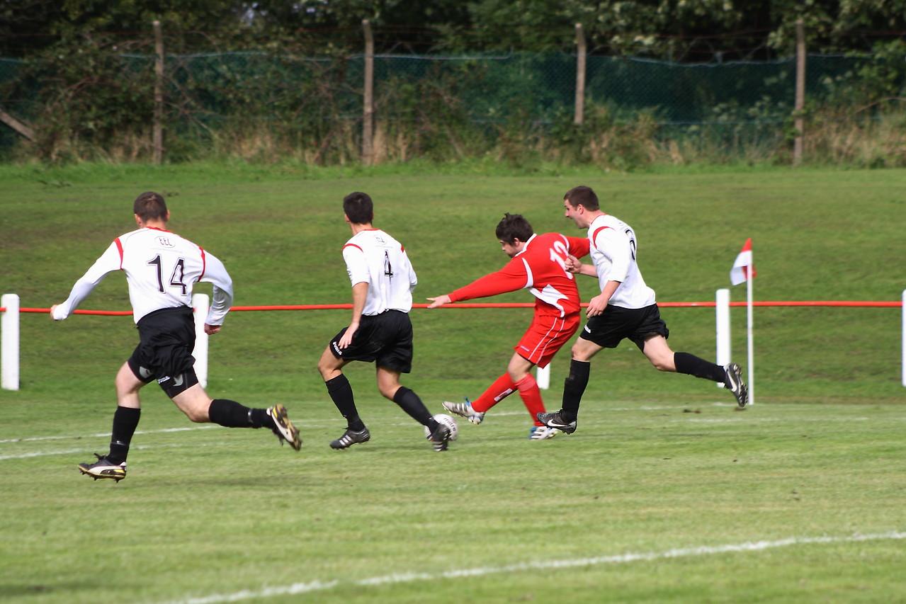Steven Fitzpatrick firing a pass across the goal