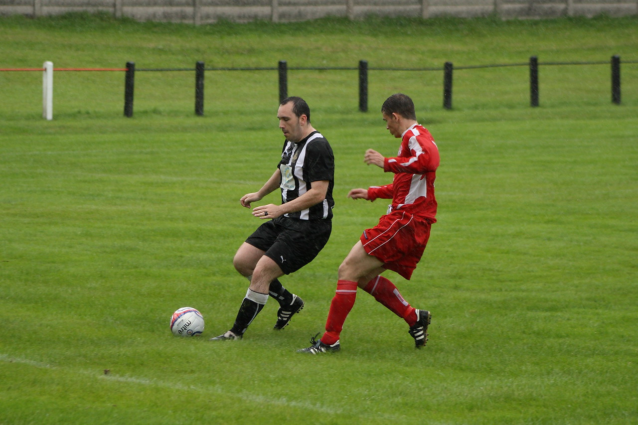 Grant Kelly about to nip the ball off the toes of the Royal Albert defender
