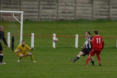 Grant Kelly tries to lift the ball over the Royal Albert keeper