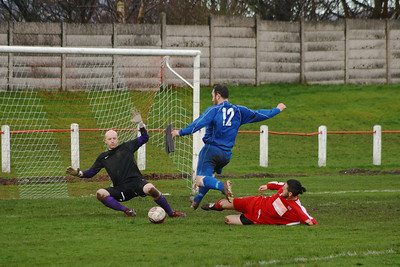 Gordon Ion tackles  Johnstone Burgh 1 Carluke Rovers 2 Stagecoach West of Scotland League Central District  First Division Keanie Park 22/03/2014