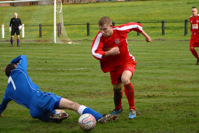 Neil Dinnen evading a tackle  Johnstone Burgh 1 Carluke Rovers 2 Stagecoach West of Scotland League Central District  First Division Keanie Park 22/03/2014