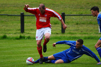 Ross Perrie evades this tackle.  Johnstone Burgh 1 Lanark Utd 5 Stagecoach West of Scotland League Central District  First Division Keanie Park 17/05/2014