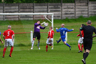 Ally Burke cuts out this cross.  Johnstone Burgh 1 Lanark Utd 5 Stagecoach West of Scotland League Central District  First Division Keanie Park 17/05/2014