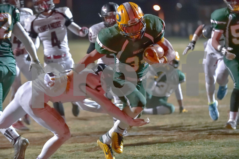 Side stepping a tackle by Linganore, Jake Funk crosses the goal line for a touch down.