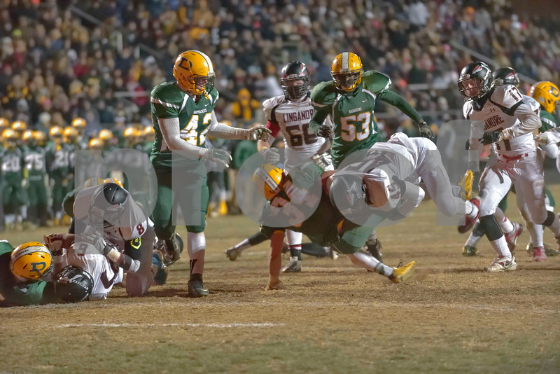 Just short of the goal line, Jake Funk gets upended by Linganore's #45.