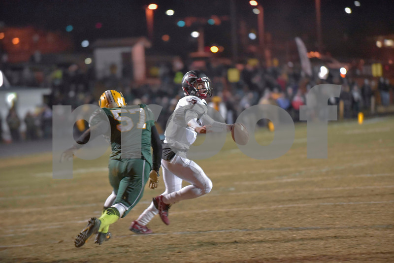 Under pressure Nathaniel Musselman rolls to his right looking for a receiver.