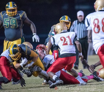 Seneca Valley's Adrian Feliz-Platt gets wrapped up by two Wheaton players  before he can score another touchdown.