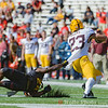 Qwuantrezz Knight a freshman defensive back refuses to let Minnesota's  Shannon Brooks get away.