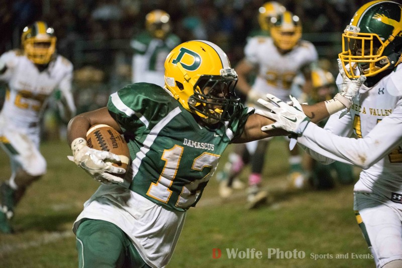 Seneca Valley's senior wide receiver Sevaun Simpson runs the right side of  the line and uses his hand for some advantage taht drew no flag.