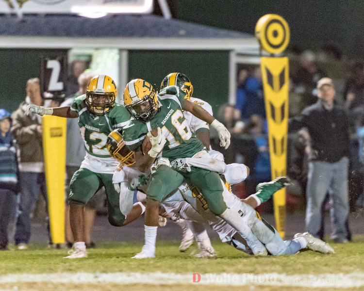 Damascus senior Markus Vinson drags 3 Seneca Valley players with him on his way to a forst down before his run is over.