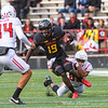 Teldrick Morgan, senior wide receiver for the Terps continues to advance despite a Rutgers defender trying to drag him to the  ground.