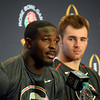 Georgia tailback Sony Michel (1) answers a question as quarterback Jake Fromm (11) looks on during the Bulldogs' press conference at the L.A. Hotel in Los Angeles, Calif., on Thursday, Dec. 28, 2017. The Bulldogs will face Oklahoma on Monday, Jan. 1, 2018, in the College Football Playoff Semifinal at the Rose Bowl Game. (Photo by Steven Colquitt)