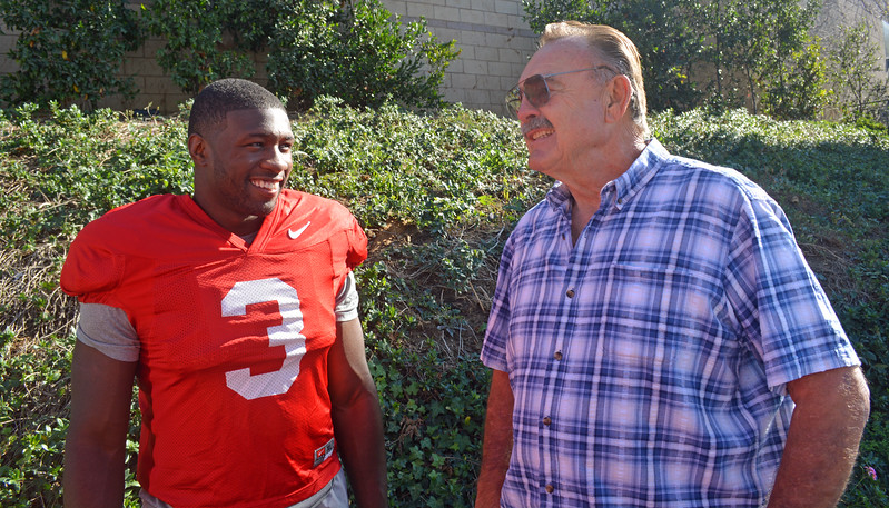 Georgia inside linebacker Roquan Smith (3) visits with Dick Butkus before the Bulldogs' practice at the StubHub Center in Carson, CA., on Friday, Dec. 29, 2017.  (Photo by Steven Colquitt / Georgia Sports Communication)