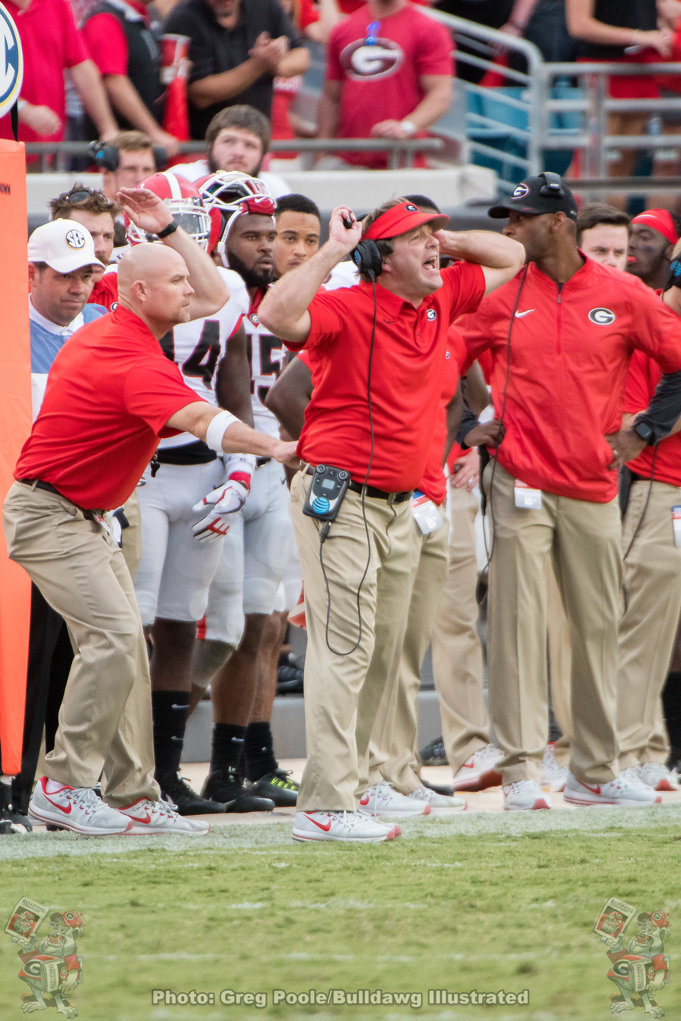 Georgia's Strength and Conditioning coach Scott Sinclair holding back head coach Kirby Smart