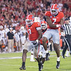 Roquan Smith and Lorenzo Carter (7)